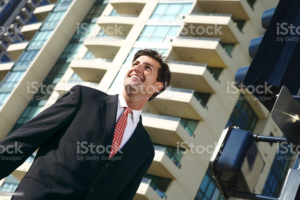 businessman walking downtown stock photo