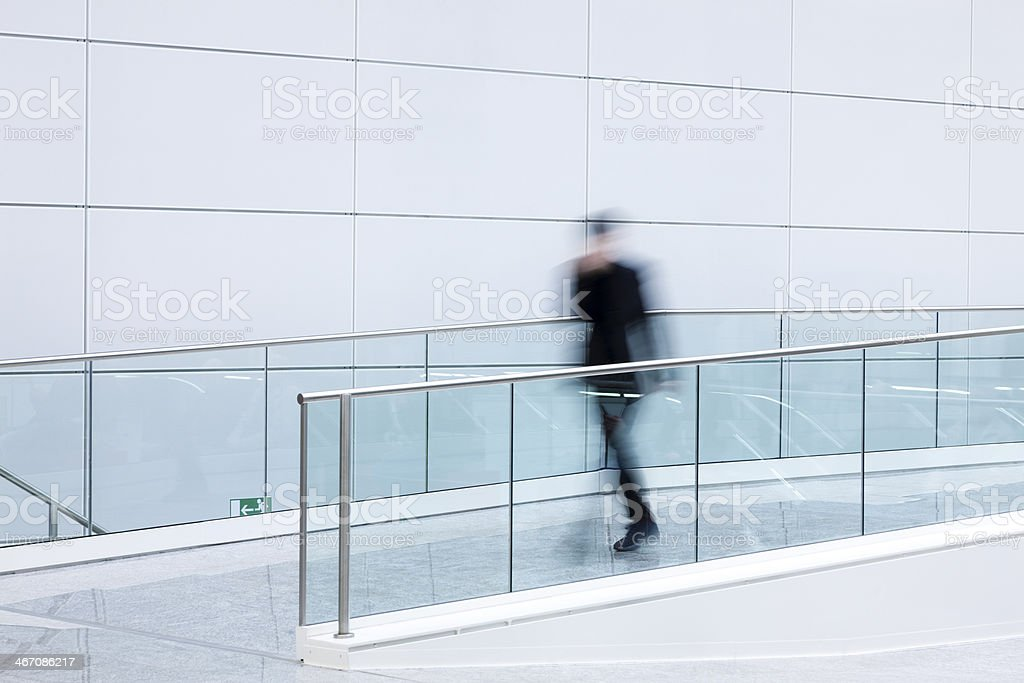 Businessman Walking in a Lobby, Blurred Motion royalty-free stock photo