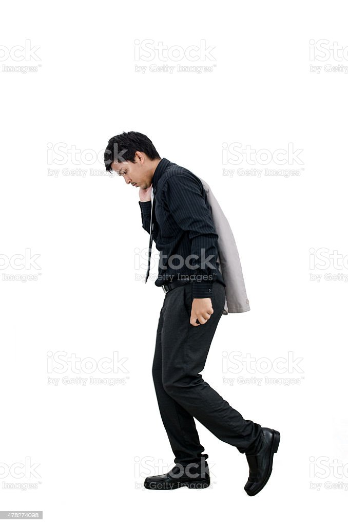 Businessman walking in failure action on white background. stock photo