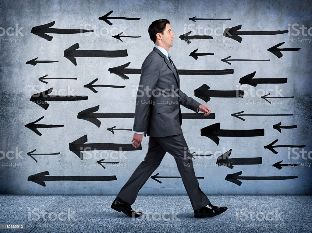 Businessman Walking In Wrong Direction stock photo
