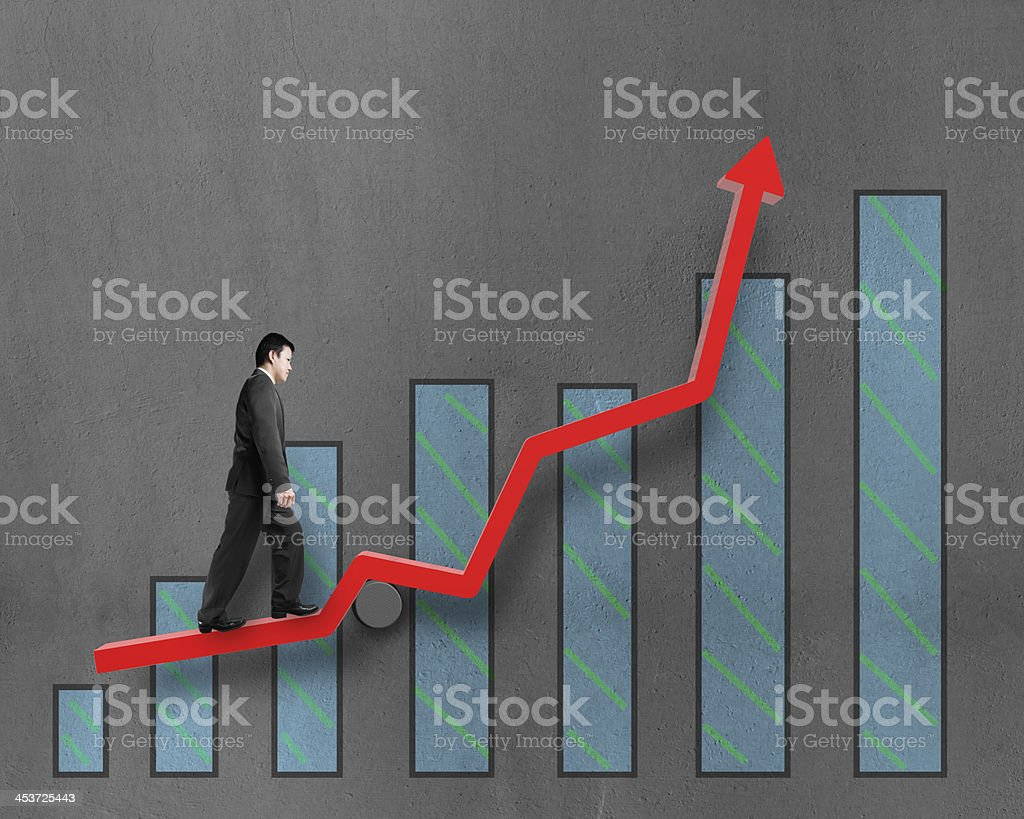 Businessman walking on growth red arrow with chart royalty-free stock photo