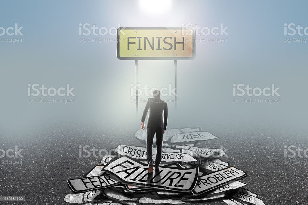 businessman walking  on problems to  finish  , success concept stock photo