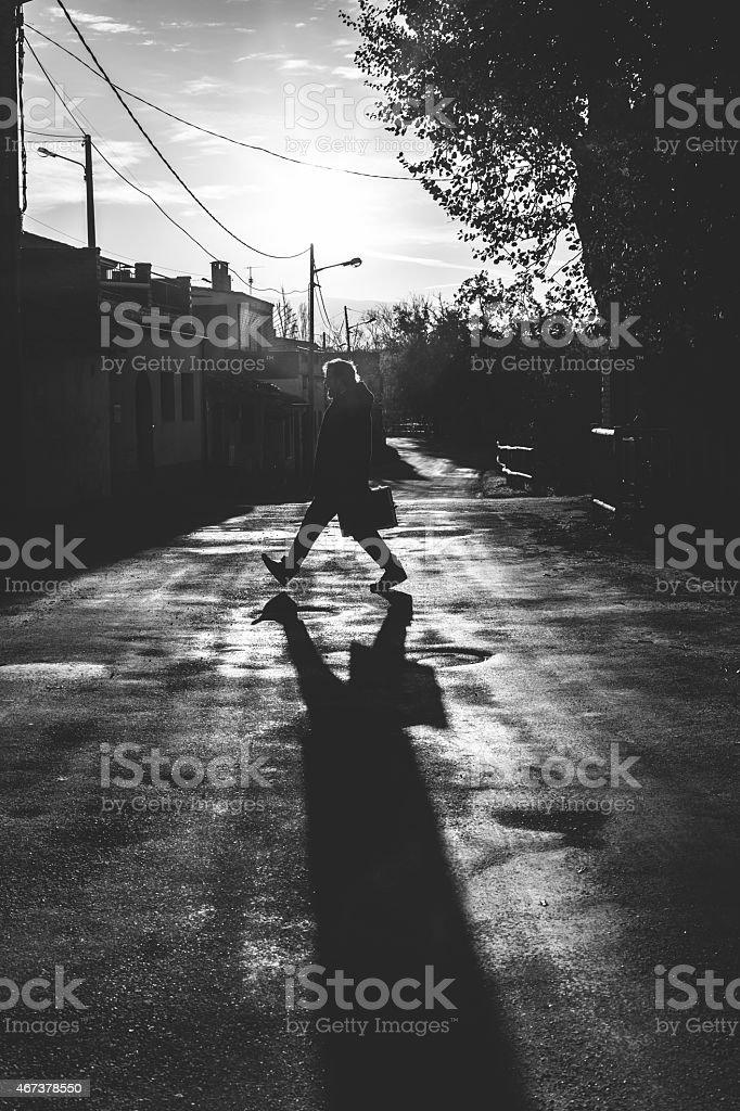 Businessman walking on road. stock photo