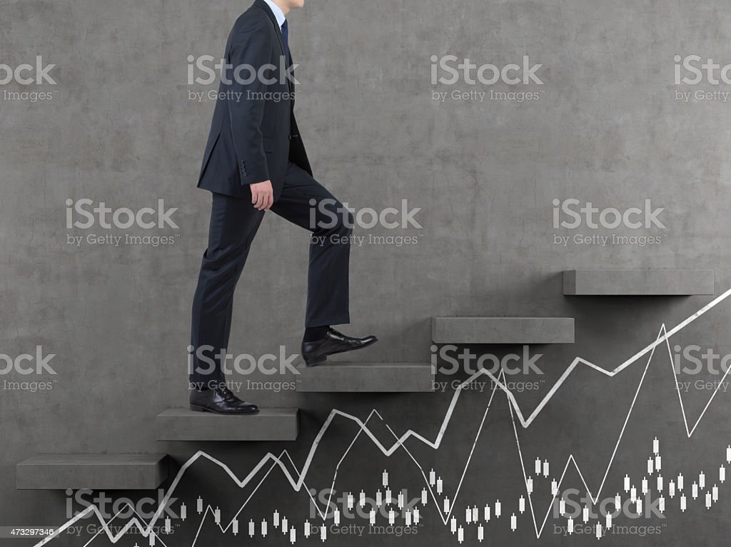 businessman walking on staircase stock photo