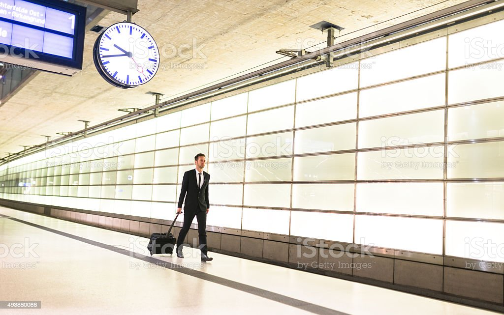 businessman walking on the train station stock photo