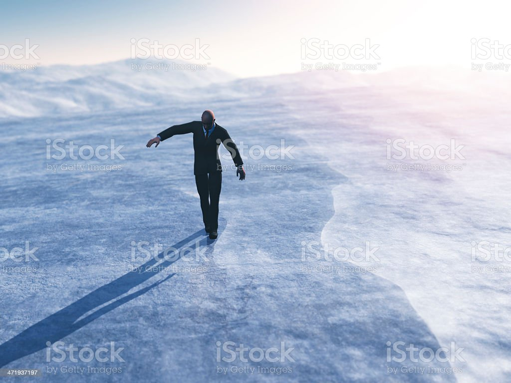 Businessman walking on thin ice stock photo