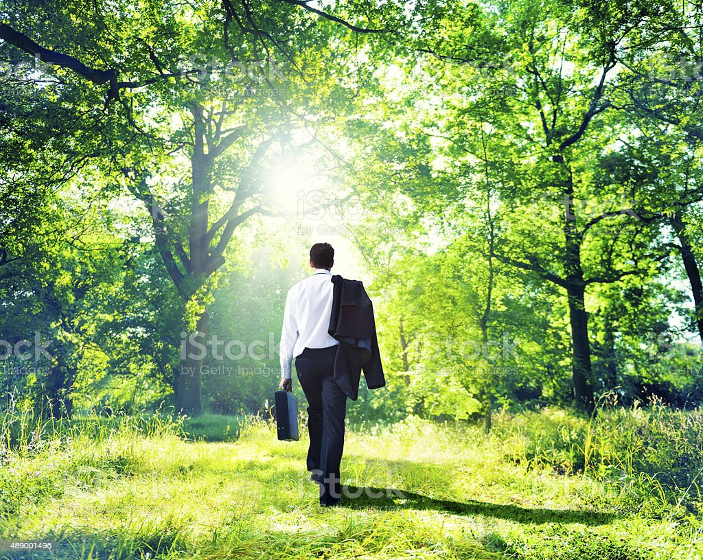 Businessman Walking Outdoors stock photo