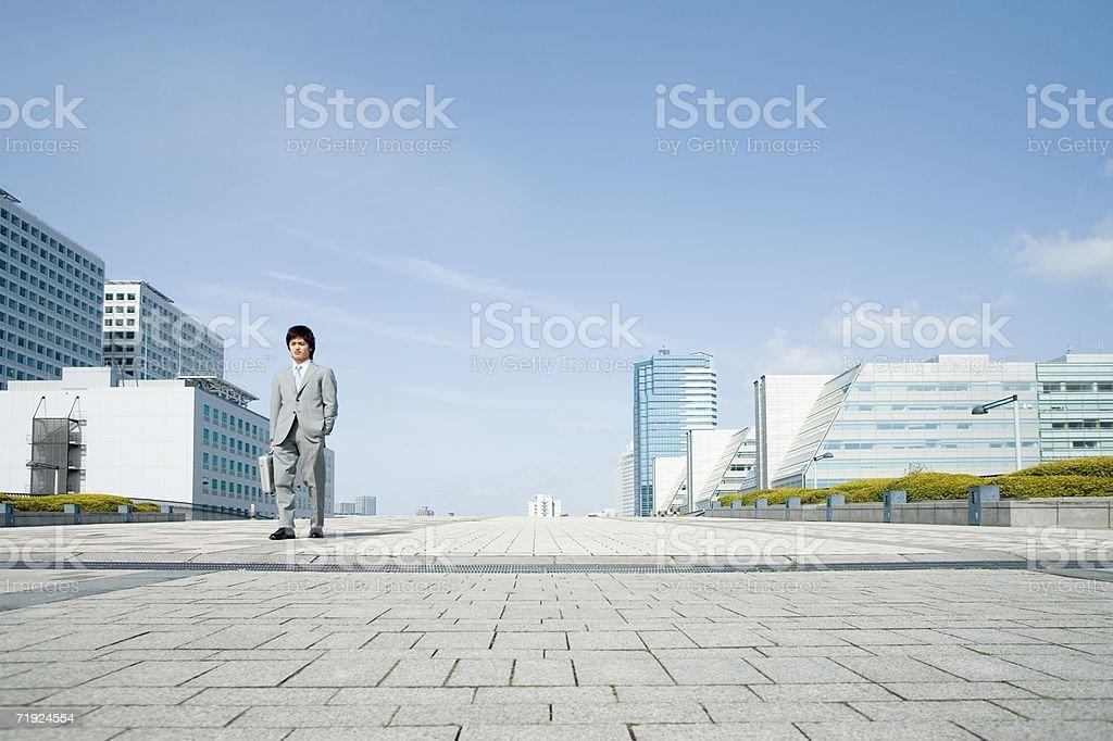 Businessman walking through financial district stock photo