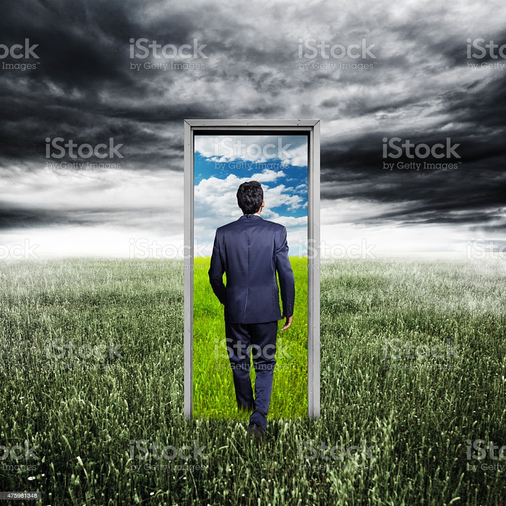 Businessman walking to opened door stock photo