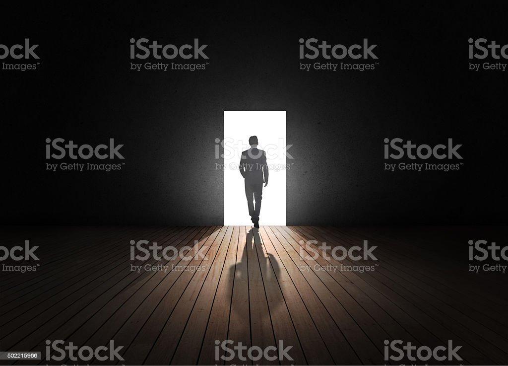 Businessman walking to opened door stock photo