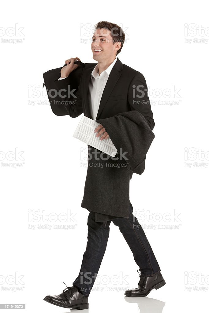Businessman walking with a briefcase and document royalty-free stock photo