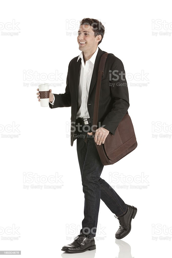 Businessman walking with a disposable cup royalty-free stock photo