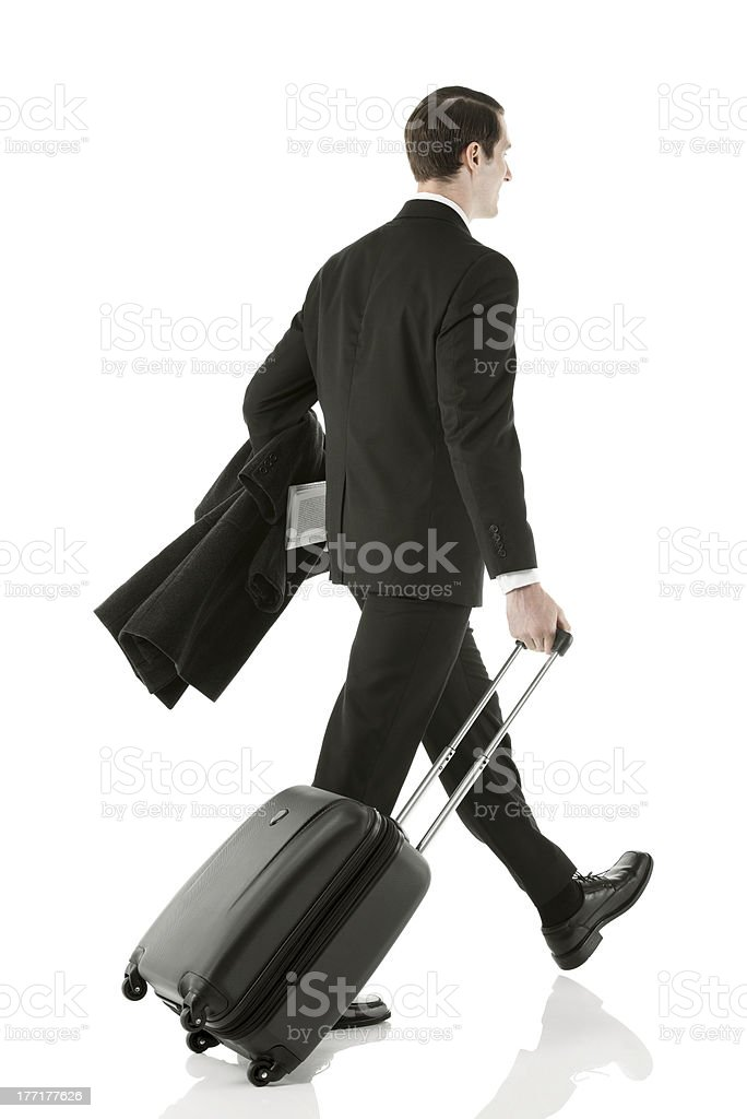 Businessman walking with luggage royalty-free stock photo