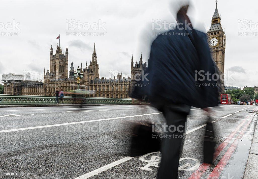 Businessman Walks on Westminster Bridge London stock photo