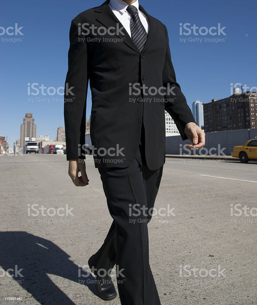 Businessman Walks on Wide City Street royalty-free stock photo