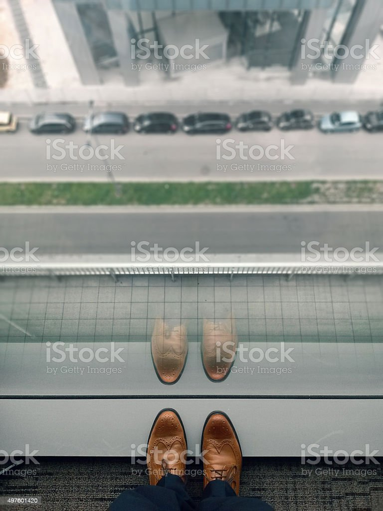 Businessman watching down stock photo