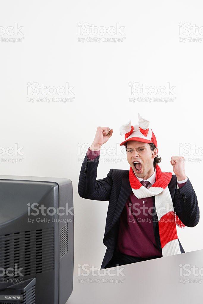 Businessman watching football stock photo