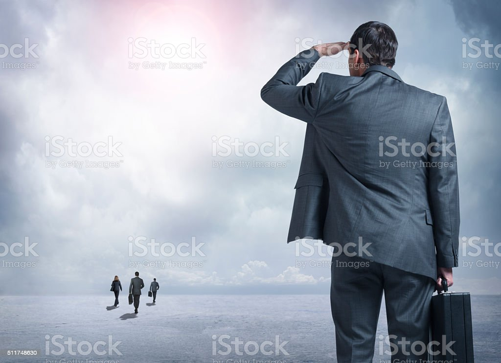 Businessman Watching His Competition Get Out In Front Of Him stock photo