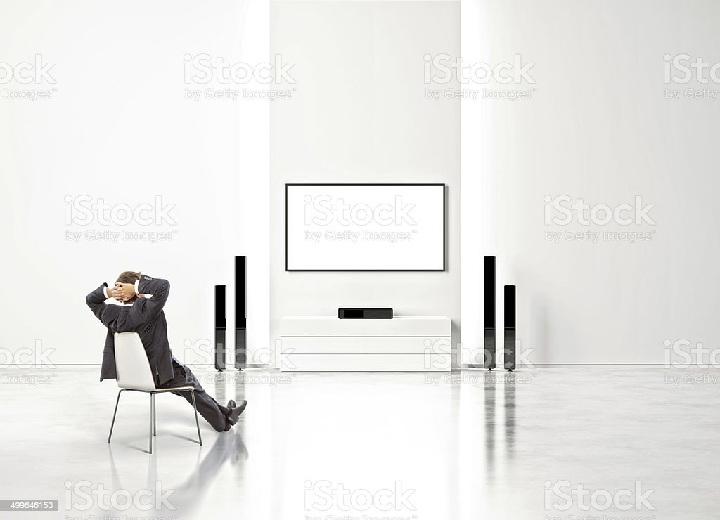 Businessman watching home cinema stock photo