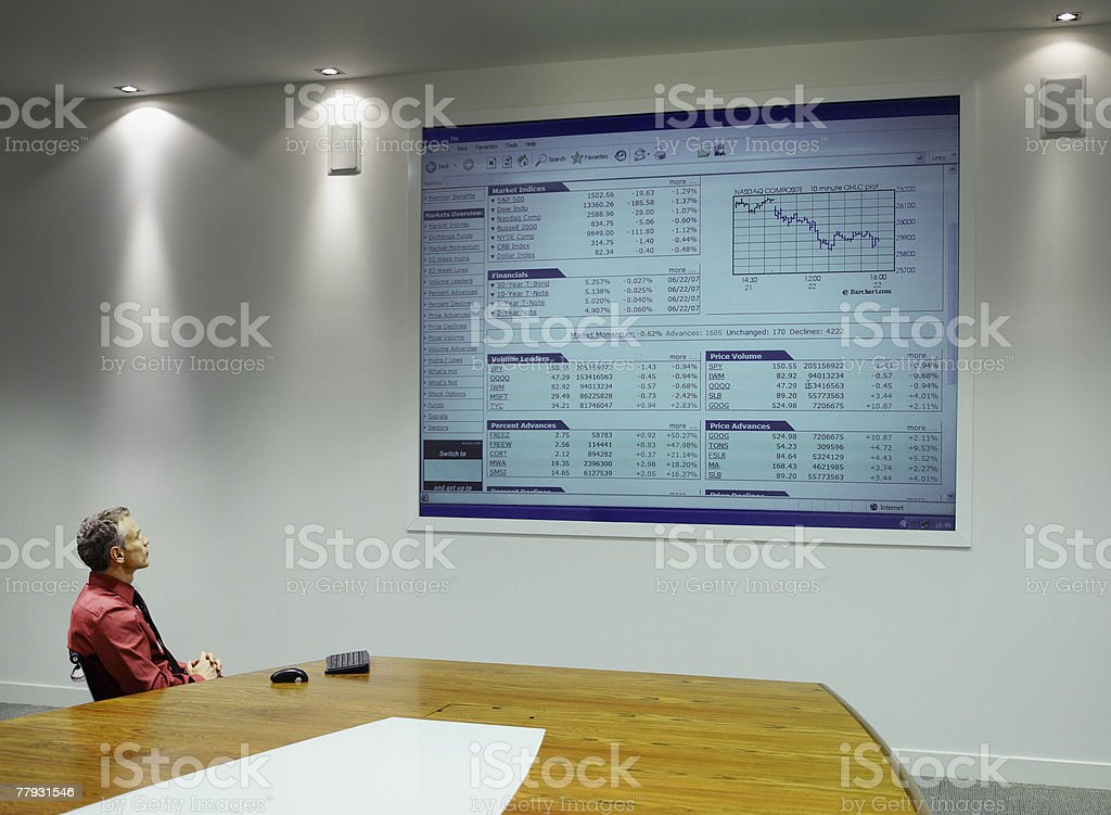 Businessman watching presentation on projection screen stock photo