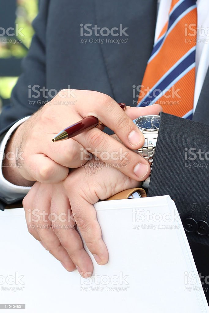 'Businessman watching the clock' royalty-free stock photo