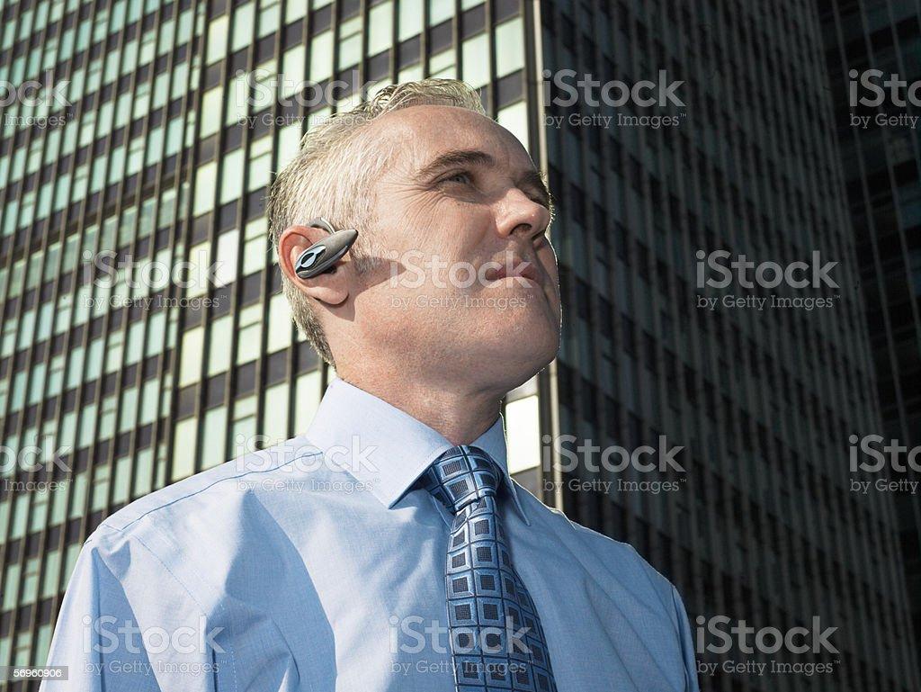 Businessman wearing a PAN headset royalty-free stock photo