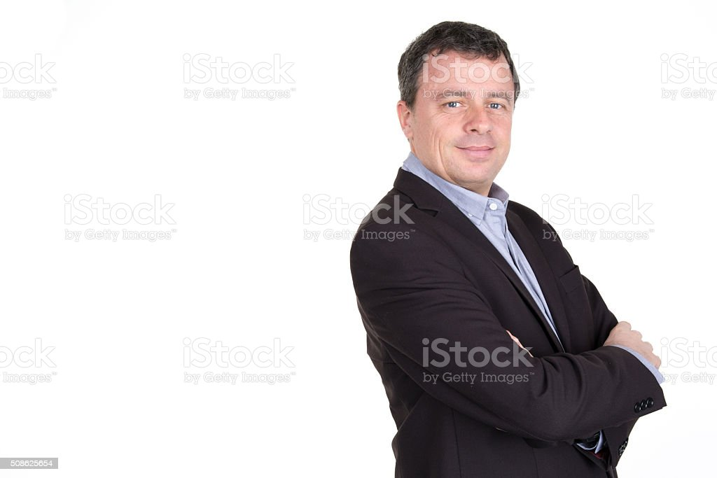 Businessman wearing a suit smiling with his arms folded stock photo