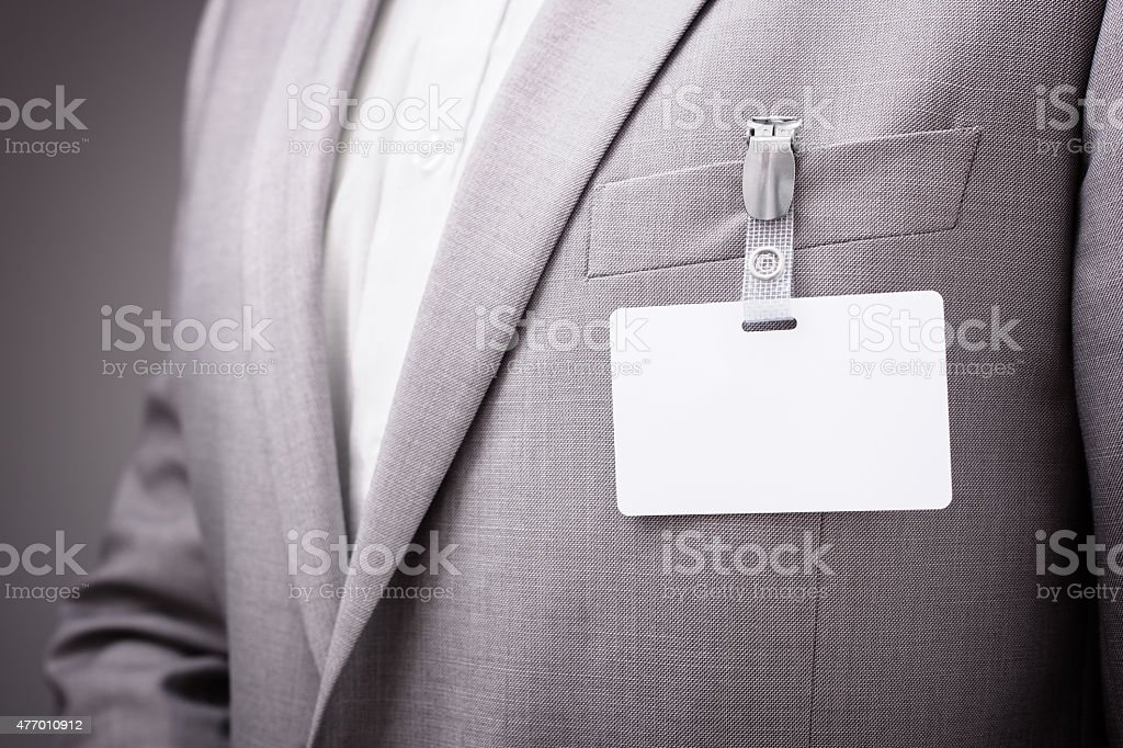Businessman wearing blank name tag stock photo
