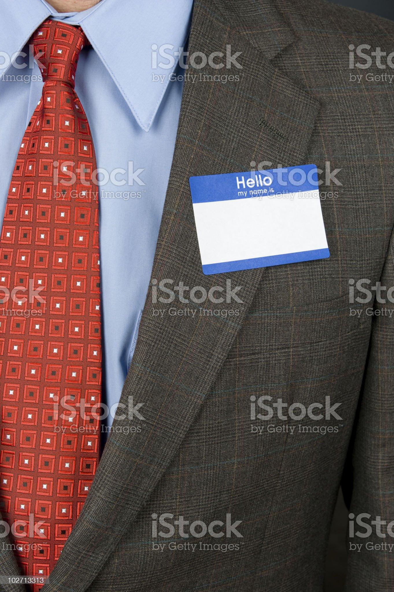 Businessman wearing blank nametag royalty-free stock photo