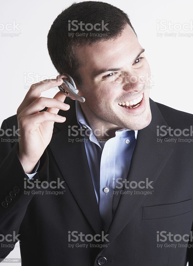 businessman wearing bluetooth wireless device royalty-free stock photo