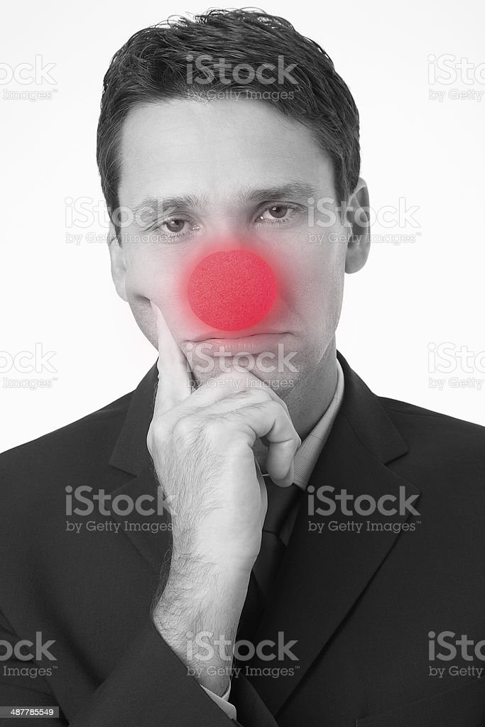 Businessman Wearing Clown Nose stock photo
