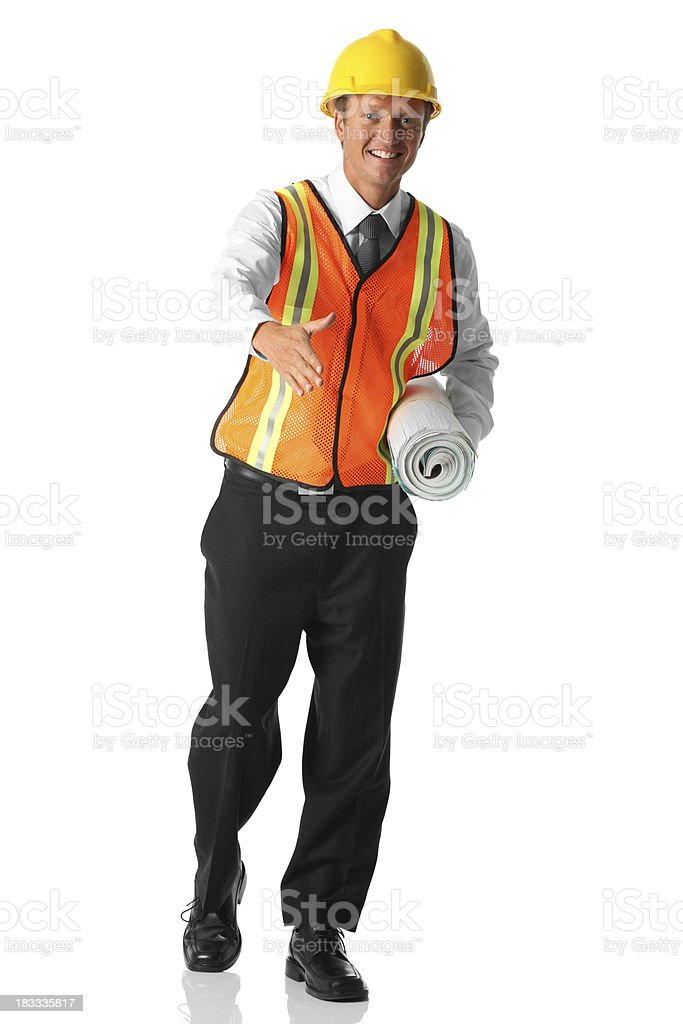 Businessman wearing construction vest and hard hat royalty-free stock photo