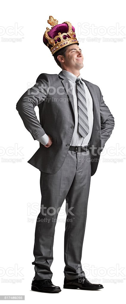 Businessman wearing Crown stock photo