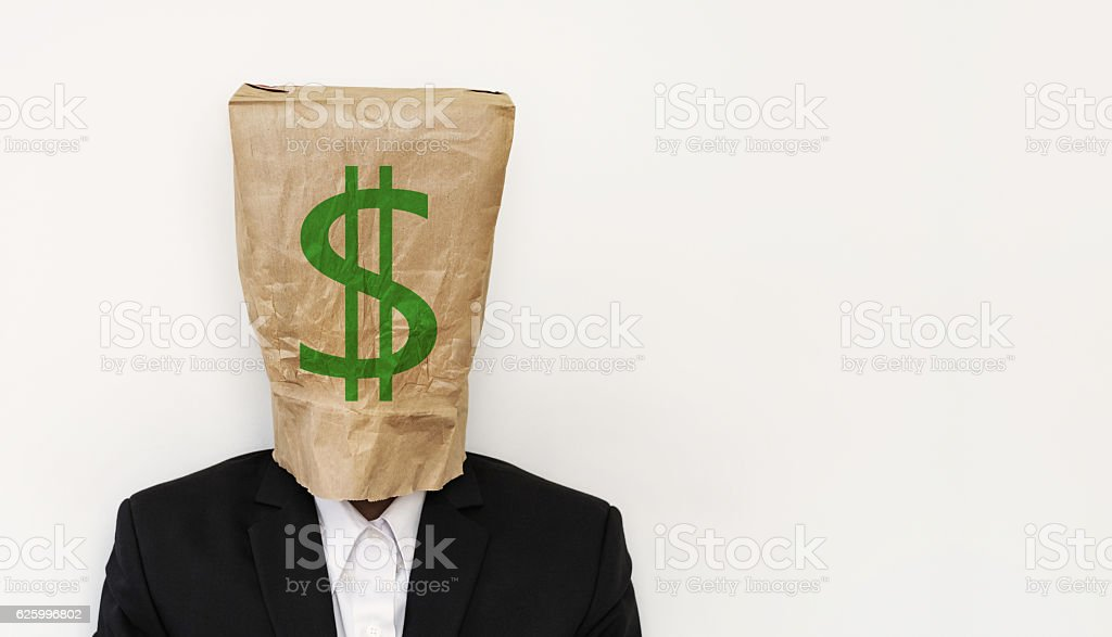 Businessman wearing crumpled brown paper bag, with green dollar sign stock photo