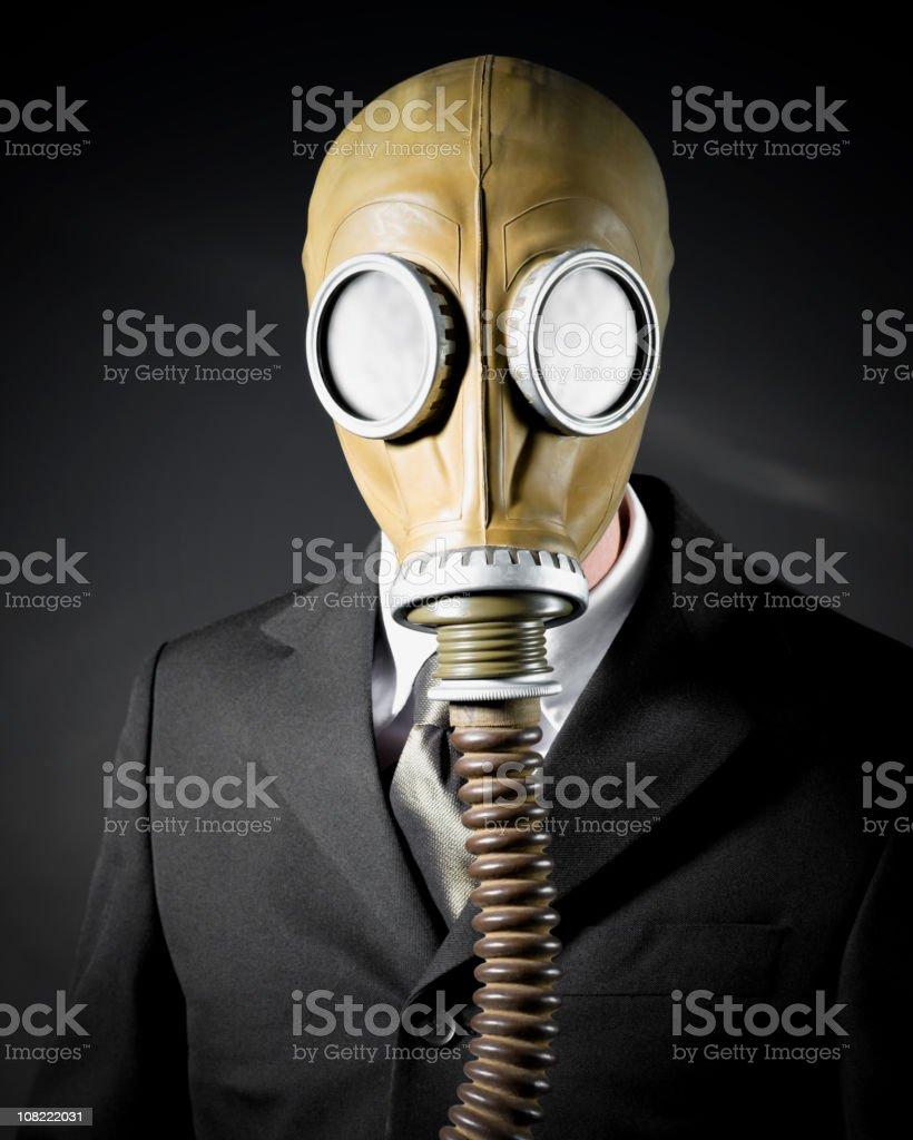 Businessman Wearing Gas Mask on Black Background stock photo
