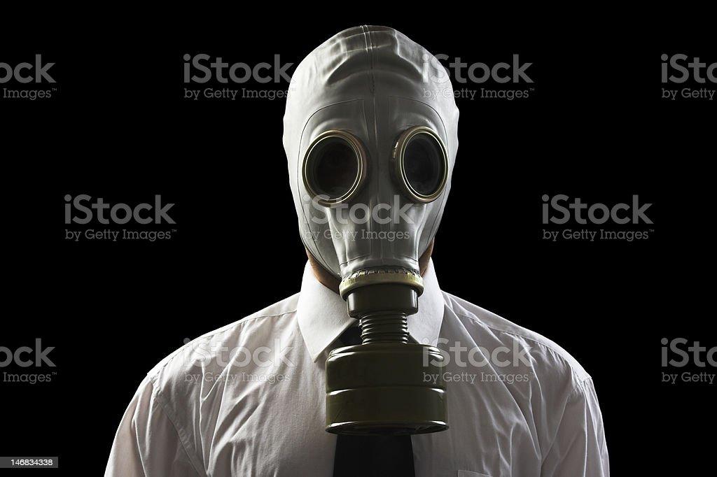 businessman wearing gas mask stock photo