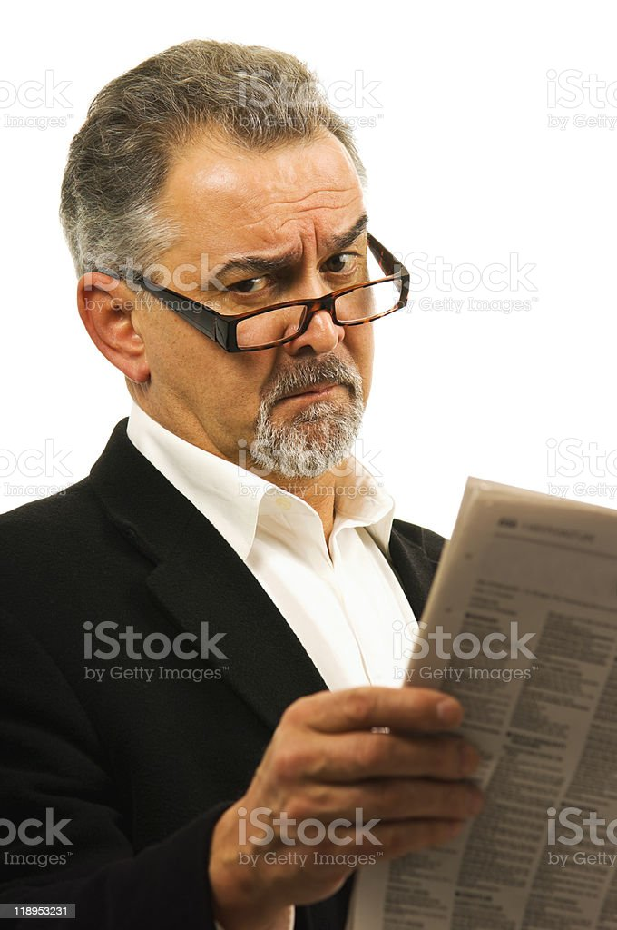 Businessman wearing glasses holds a newspaper. royalty-free stock photo