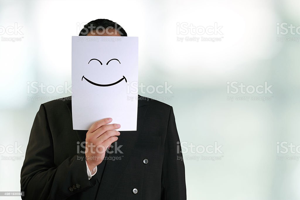 Businessman Wearing Happy Smiling Face Mask stock photo