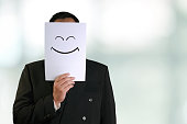 Businessman Wearing Happy Smiling Face Mask