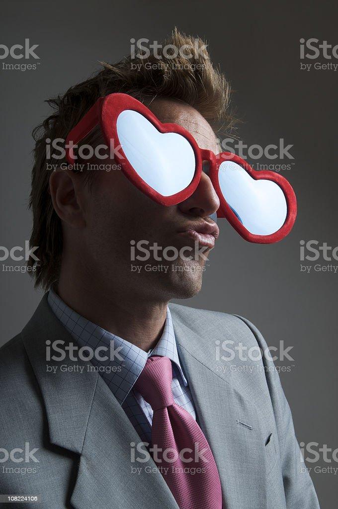 Businessman Wearing Large Heart-Shaped Glasses royalty-free stock photo