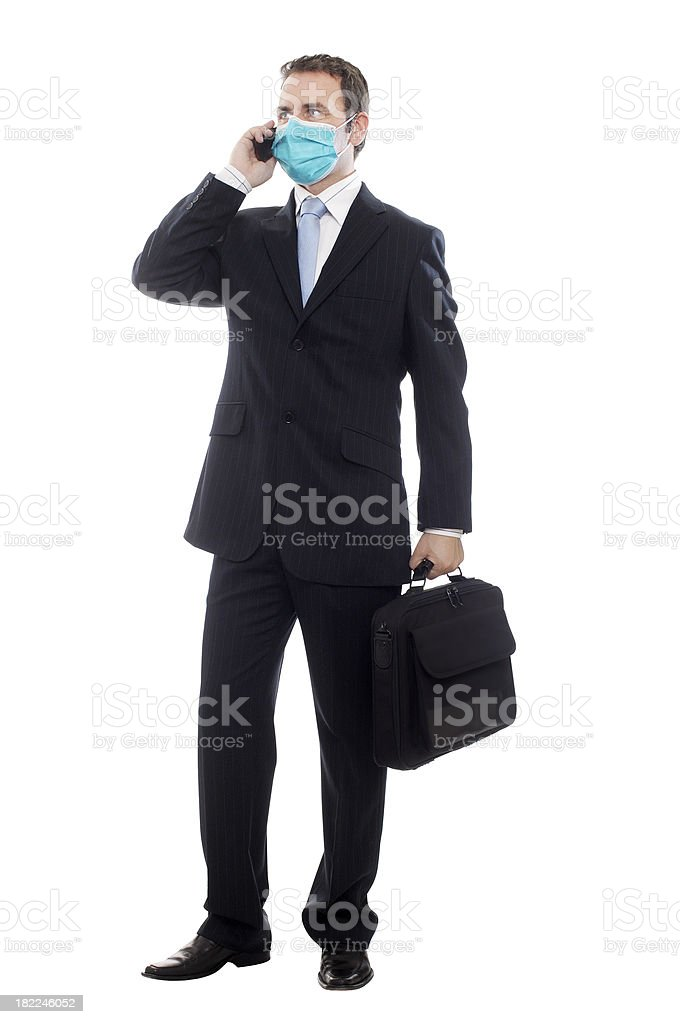 Businessman wearing mask while on the phone stock photo