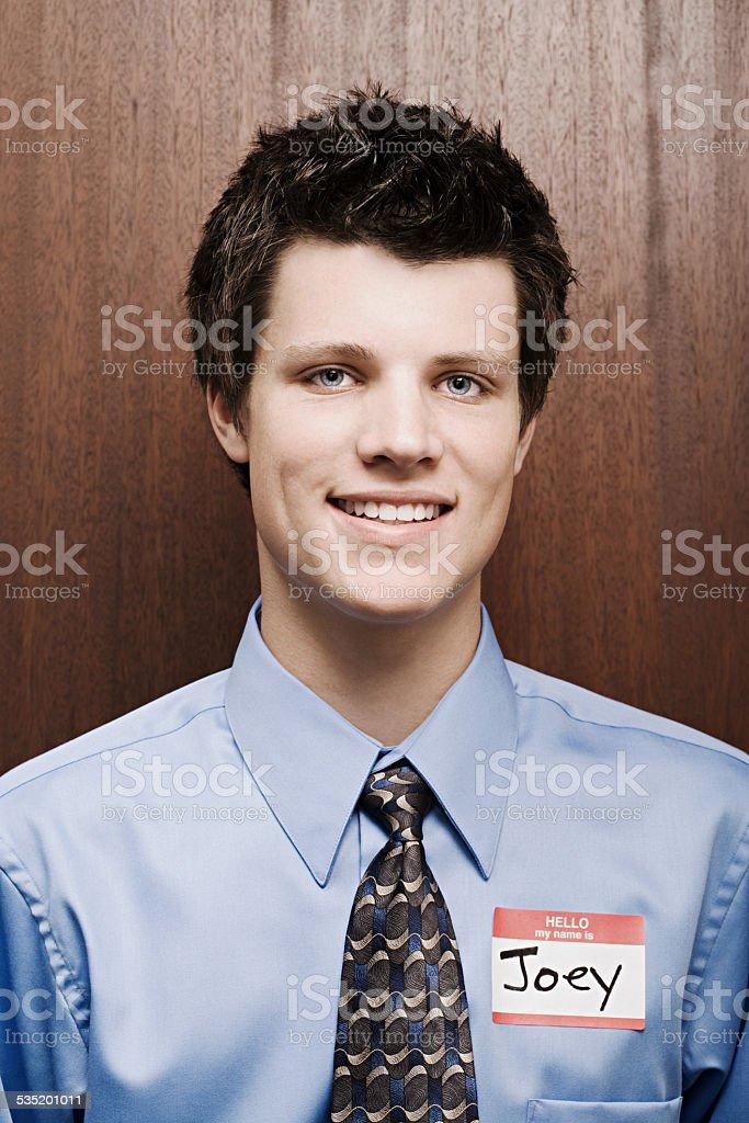 Businessman wearing name tag stock photo