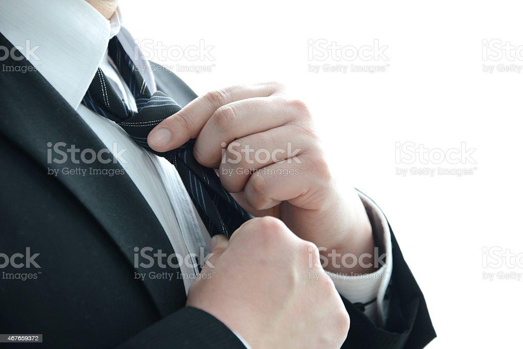 Businessman wearing necktie stock photo