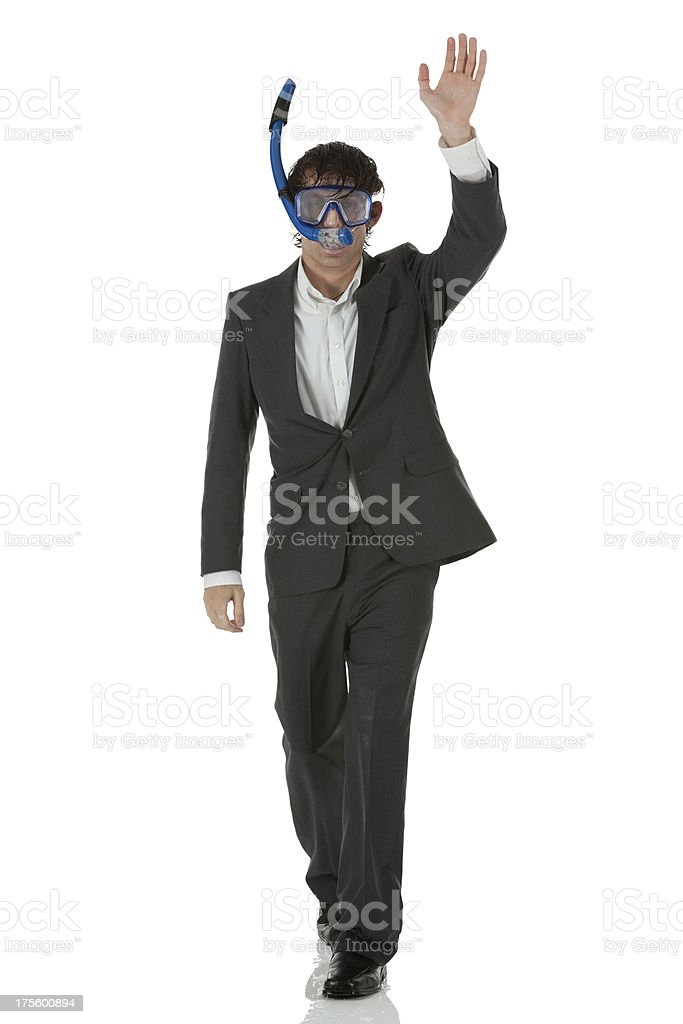 Businessman wearing scuba mask and waving stock photo