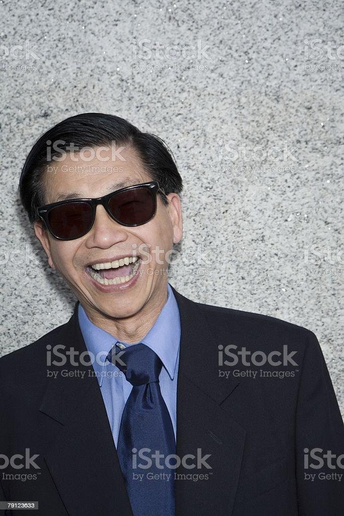 Businessman wearing sunglasses stock photo