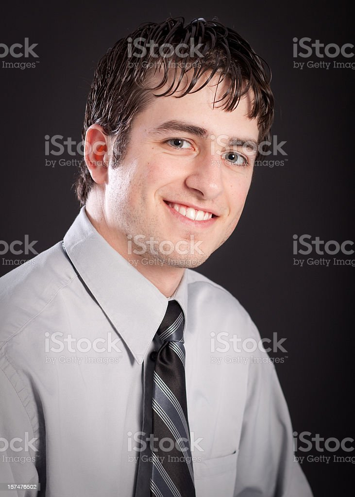 Businessman Wearing Tie Studio Head Shot Black Background royalty-free stock photo
