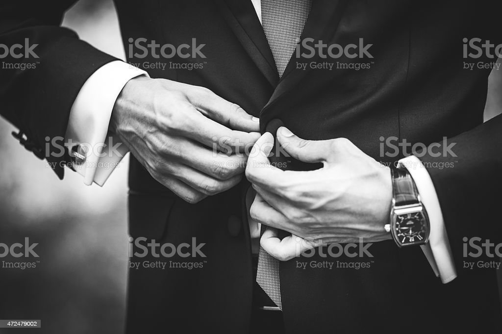 businessman who wears a suit stock photo