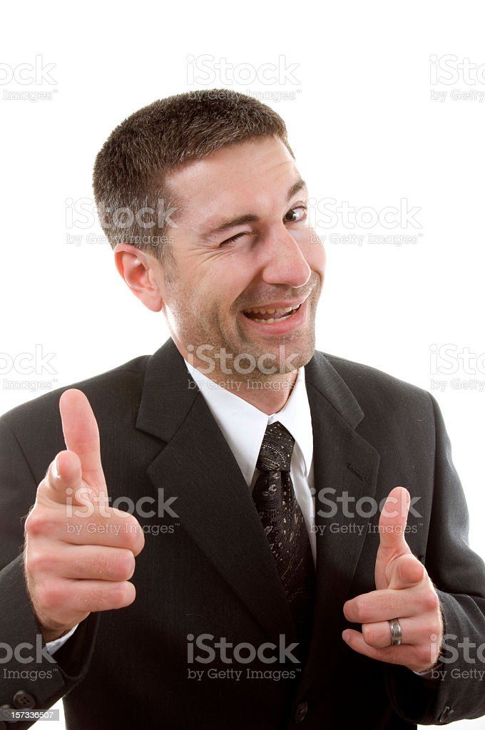 Businessman winking and pointing at the camera stock photo