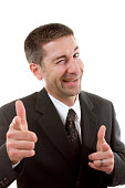 Businessman winking and pointing at the camera