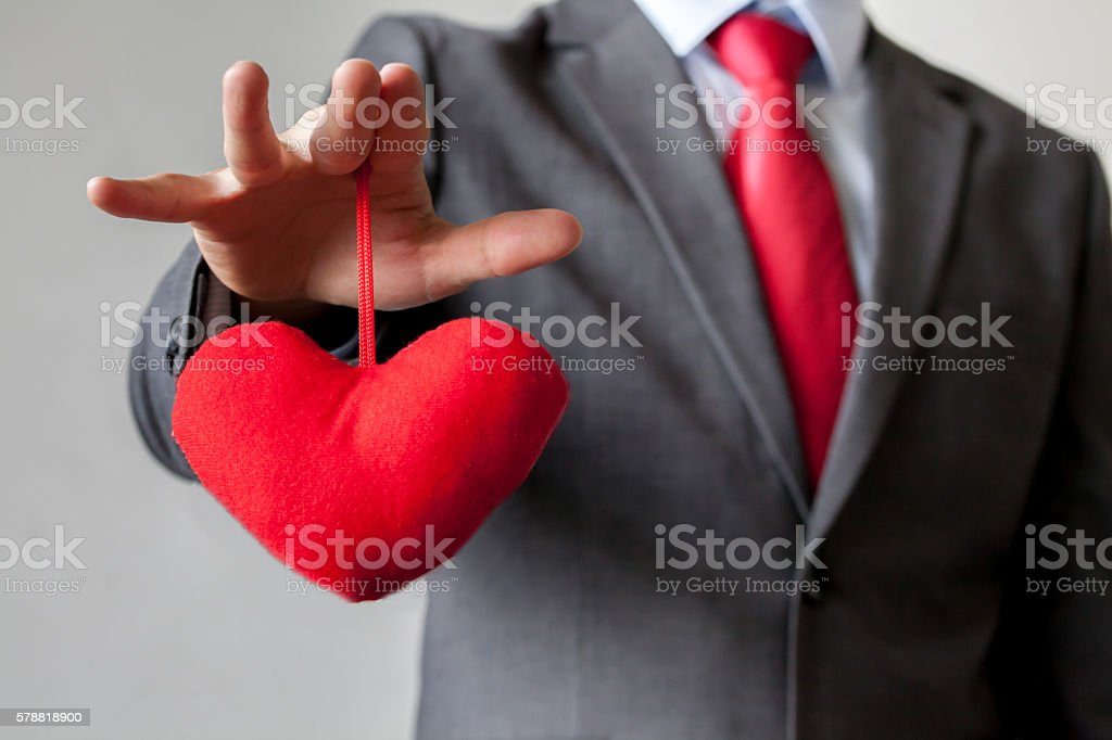 Businessman winning and controling customer's heart concept stock photo